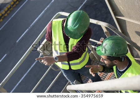 Commercial docks worker and inspector at work theme concept/Two Egyptian Arabic Inspector at Arabian port in Middle East Africa  - stock photo