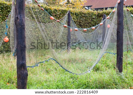 Commercial Fishing Net Hanging to Dry - stock photo
