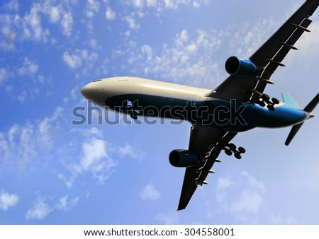 commercial flight of airplane close up view flying on blue sky with clouds during  take off procedure in transportation, business travel and holiday journey concept - stock photo