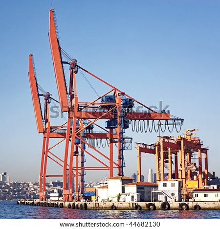Commercial harbor with large industrial cranes - stock photo