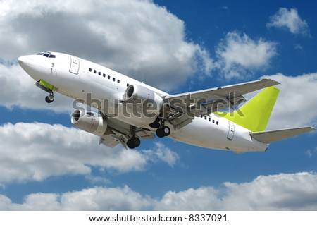 Commercial jet plane takkeoff with many clouds - stock photo