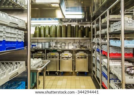 Commercial kitchen dishwashing area - stock photo