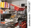 Commercial kitchen of a fast food restaurant - stock photo