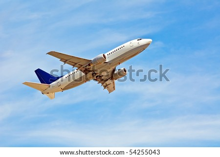 Commercial liner in the blue sky - stock photo