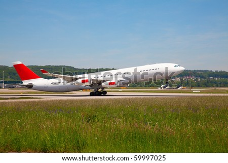 Commercial liner taking off from the runway - stock photo