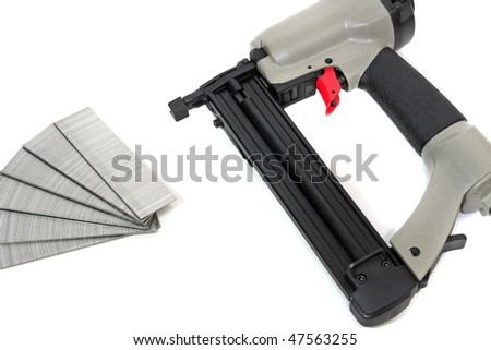 Commercial nail gun for wood framing construction - stock photo