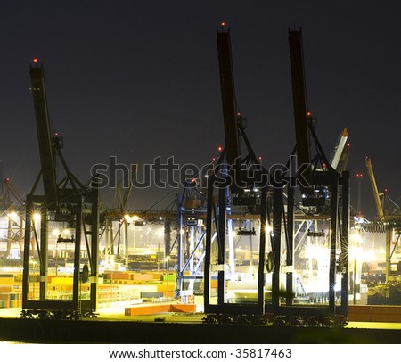 Commercial port at night - stock photo