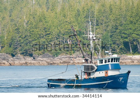 Commercial salmon fishermen in Alaska. - stock photo