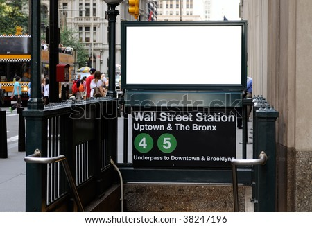 Commercial sign in Wall Street subway station. Blank billboard with crowd and traffic in the background. Manhattan Financial District, New York City. - stock photo