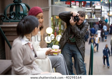 Commercial stock photographer during a photo shoot.  Shallow depth of field. - stock photo