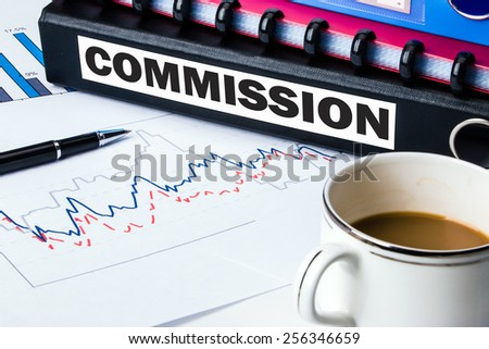 commission label on business document folder - stock photo