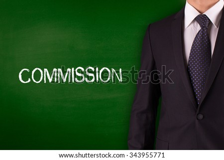 COMMISSION on Blackboard with businessman - stock photo