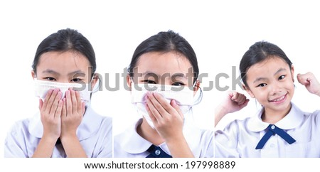Common cold little asia girl with facemask in white isolated background - stock photo