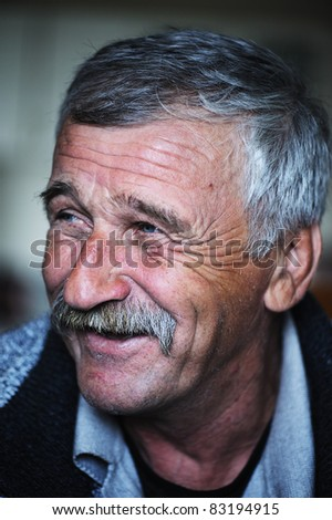 Common elderly positive man with mustache, happy smiling - stock photo