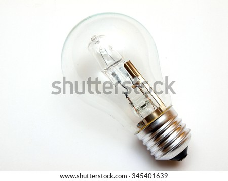 Common light bulb with halogen lamp mounted inside close up.       - stock photo