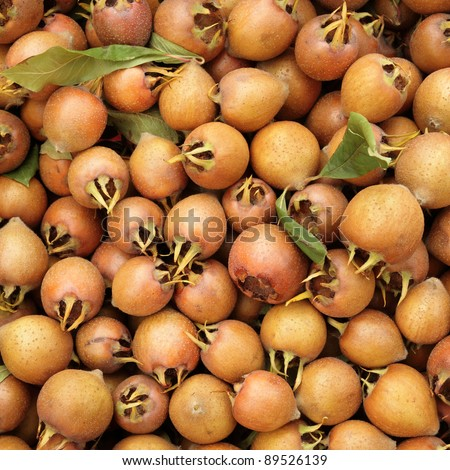 common medlar ( Mespilus germanica ) as background, market in Italy - stock photo
