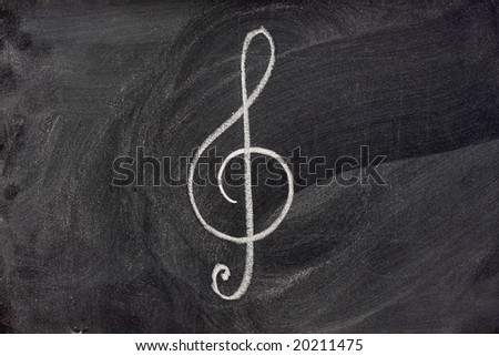 common musical notation sign, treble clef or music symbol in general, sketched with white chalk on blackboard - stock photo
