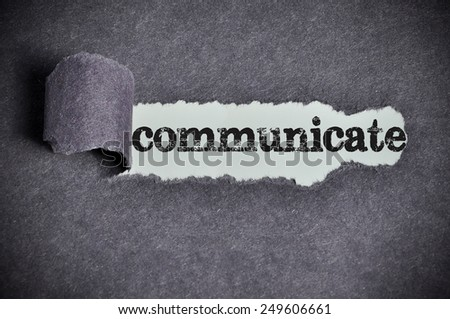 communicate word under torn black sugar paper  - stock photo