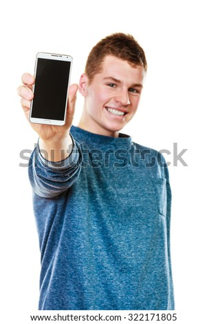 Communication and advertisement. Happy young man showing cell phone smartphone black blank screen isolated on white - stock photo