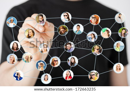 communication and networking concept - closeup of man drawing social network on virtual scneen - stock photo