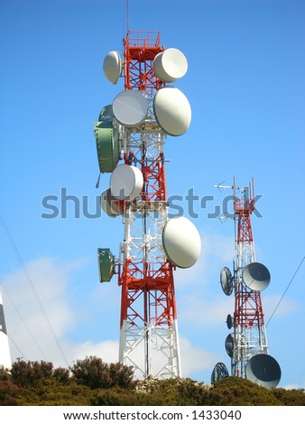 communication antenna with an array of dishes - stock photo