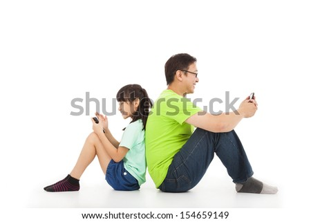 communication between father and daughter by smart phone - stock photo