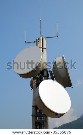 Communication cell tower for wireless technology: Gsm, Hsdpa, Umts, Gprs, Edge, Hsupa. - stock photo