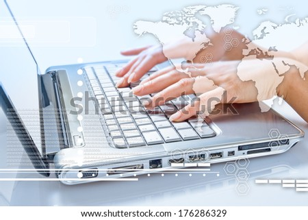 communication concept. Business woman typing on the keyboard of his laptop