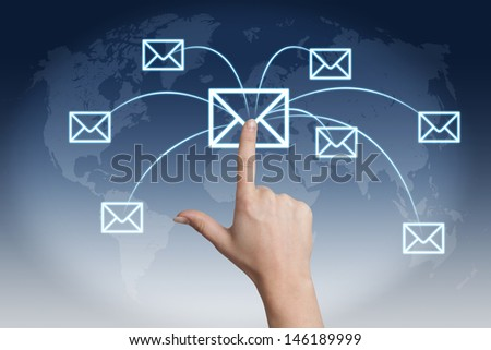 Communication concept: Hand pressing a letter icon on a world map interface  - stock photo