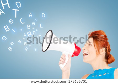 communication concept - redhead woman with megaphone over blue background - stock photo
