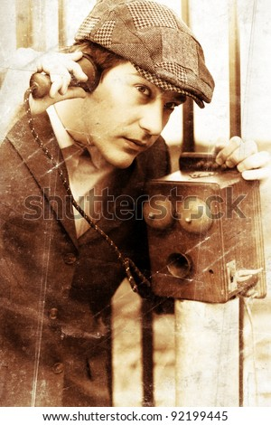 Communication From Yesteryear With A Old Fashioned Vintage Man Talking And Listening Through An Antique Phone, Photograph Contain Grain Artifacts And Distortion - stock photo
