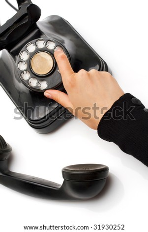 communication; making a phone call on a vintage black telephone - stock photo