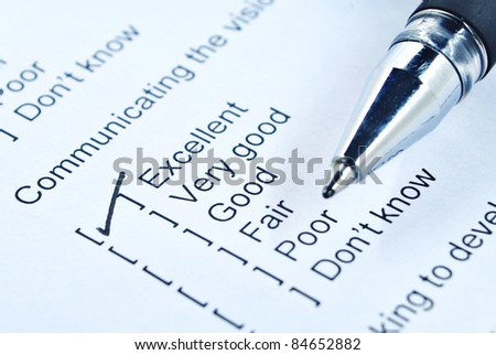 Communication survey form and pen tick in box - stock photo