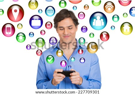 communication technology mobile phone high tech concept. Happy business man using texting on smartphone social media application icons flying out of cellphone isolated white background. 4g data plan  - stock photo