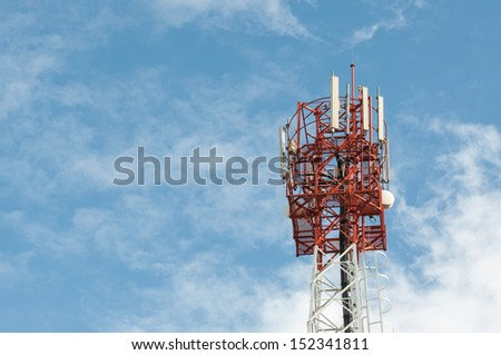 Communication tower on blue sky.