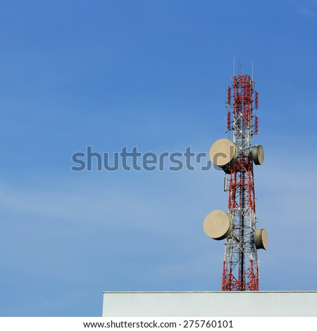 communication tower on blue sky background - stock photo
