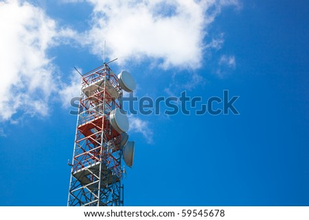Communication tower over a blue sky - stock photo