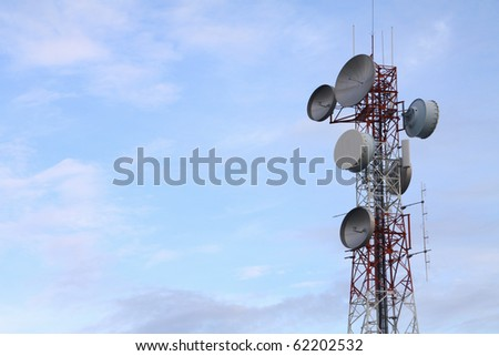 Communication tower over a  blue sky. - stock photo