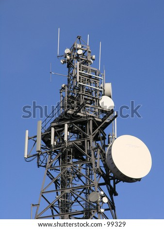 Communication tower showing dishes and antennas.