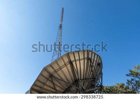 communication tower with analog television antenna transmitters - stock photo