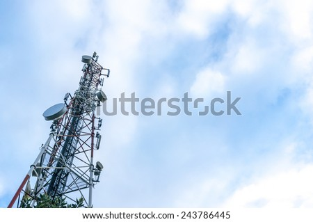 Communication tower with blue skies - stock photo