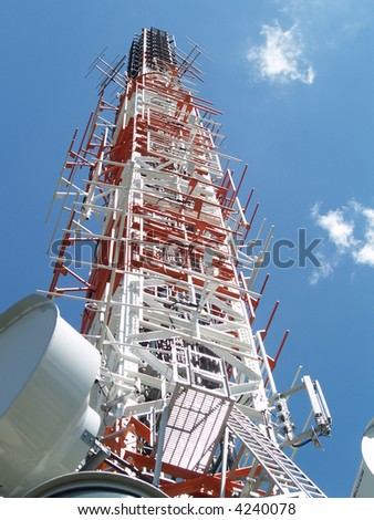 Communication tower with tv and radio antenna - stock photo