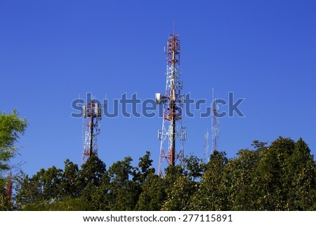 Communication Towers with shot wave Radio, Parabolic and GSM Antennas - stock photo