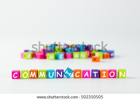 Communication word spelled with colourful wooden block over white background