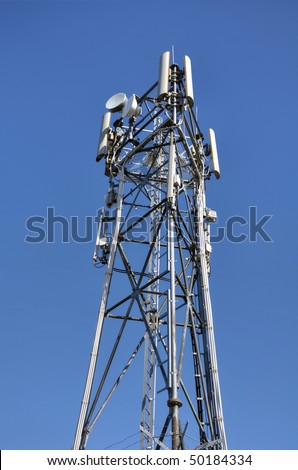 Communications mast with blue sky background