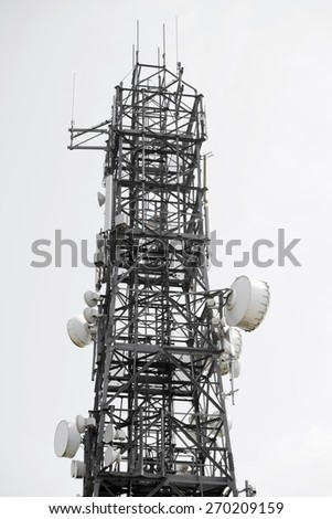 communications tower against a white sky in ireland - stock photo