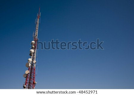 Communications Tower Against Blue Sky - stock photo