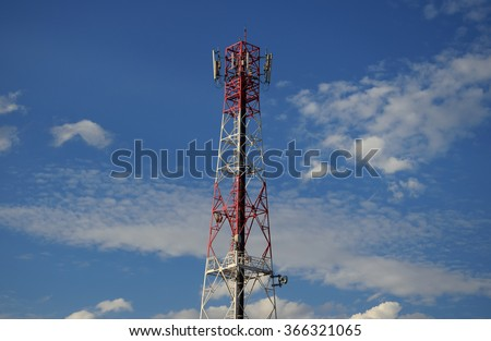 communications tower and satellite on blue sky