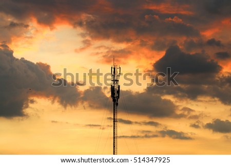 Communications tower with a beautiful sunset sky