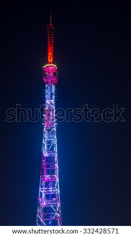 Communications TV tower at night with stars on the sky. - stock photo